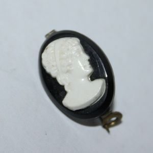 Vintage black and white cameo brooch